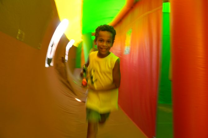 Boy running Inside the Fun Maze Inflatable (LASER TAG MAZE)